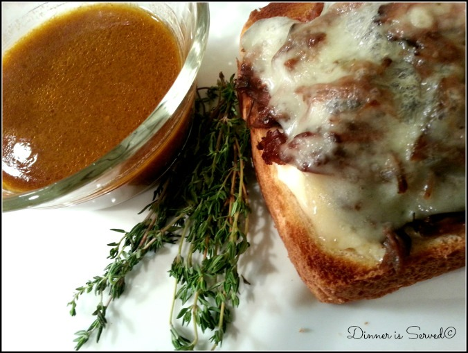 Slow Cooker Pot Roast Sandwich with Swiss Cheese and Thyme Au Jus | Dinner Is Served